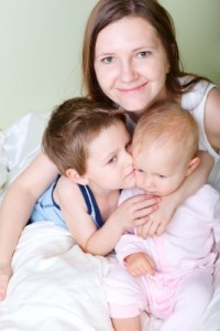 young mom with her kids