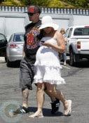 A pregnant Pink (Alecia Moore) and husband Carey Hart