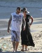 An expectant Pink and husband Carey Hart