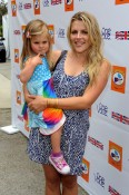 Actress Busy Philipps with daughter Birdie at kidstock 2011
