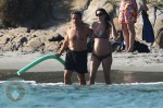 A pregnant Carla Bruni and husband Nicolas Sarkozy on Fort de Brégançon beach