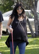 A very pregnant Selma Blair strolls with her dog