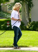 A pregnant January Jones walks her dog