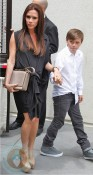 A pregnant Victoria Beckham with son Brooklyn