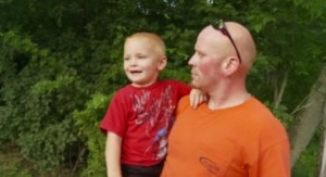 dad and son after well rescue