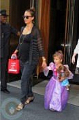 A pregnant Jessica Alba with her daughter Honor