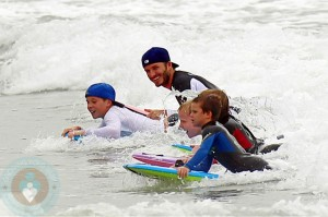 David Beckham surfing with his son Brooklyn, Romeo and Cruz