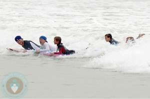 David Beckham boogie boards with his son Brooklyn, Romeo and Cruz