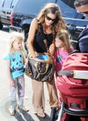 Denise Richards at JFK with daughters Sam and Lola