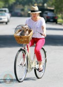 Hilary Duff biking with her dog in Malibu