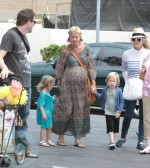 A pregnant Tori Spelling with Bill Horn and kids Liam and Stella