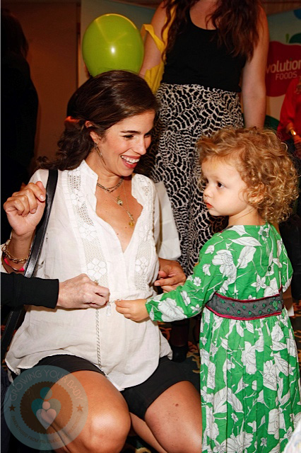 A pregnant Ana Ortiz with daughter Paloma