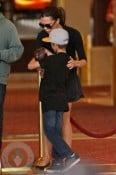 Romeo Beckham holds his sister Harper