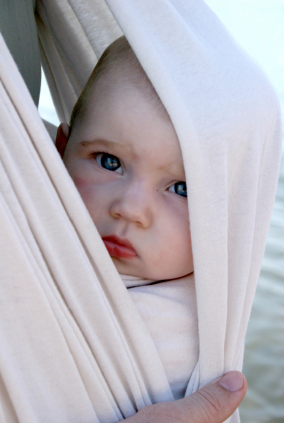 Baby in a sling (stock)