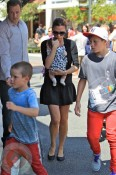 Victoria carries Harper while out shopping with Brooklyn and Cruz