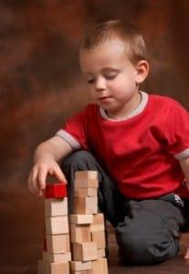 Boy stacking blocks (stock photo)