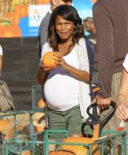 A very pregnant Nia Long at Mr. Bones Pumpkin Patch