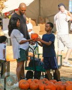 A very pregnant Nia Long with boyfriend Ime Udoka and son Massai, 11