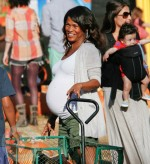 A very pregnant Nia Long at Mr