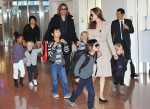 Brad Pitt and Angelia land in Tokyo with their 6 kids