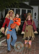 Alyson Hannigan, Alexis Densiof and daughter Satyana go trick or treating