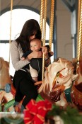 Selma Blair and son Arthur ride the carousel at the Santa Monica Pier