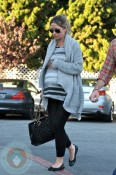 Pregnant Rebecca Gayheart grocery shopping with her husband