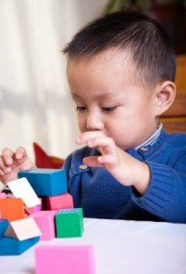 Autism child building blocks