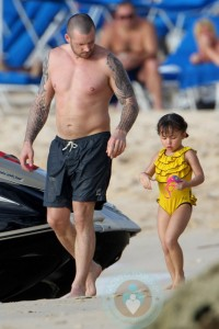 Graham and Ava Quinn at the beach in Barbados