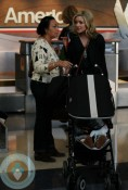 Jane Krakowski with son Bennet at the airport
