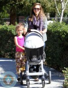 Jessica Alba and Honor Warren scoot at the park