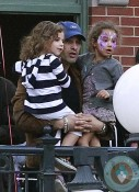 Olivier Martinez and Nahla Aubry watch the parade at Disneyland