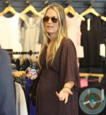 Pregnant Molly Sims Shops in LA