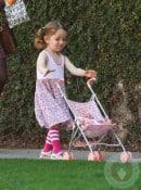 Satyana Denisoff pushes her baby in LA