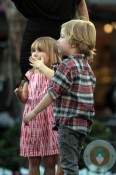 Stella and Liam McDermott filming a segment at the grove