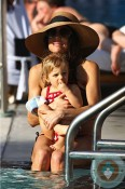 Bethenny Frankel and daughter Brynn poolside