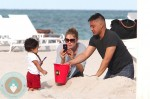 Doutzen Kroes & her son Phyllon at the beach in Miami
