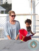 Doutzen Kroes & son Phyllon at the beach in Miami