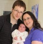 Parents Gemma and James cuddle Suzie