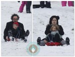 Tim Burton and Helena Bonham Carter sled with their kids