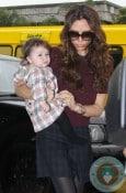 Victoria and Harper Beckham at LAX