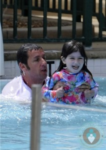 Adam Sander with daughter Sunny in the pool in Miami