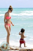 Doutzen Kroes and Phyllon James at the beach