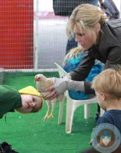Julie Bowen with twins John and Gus Phillips at petting zoo