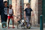 Shiloh, MAddox and Zahara walk the dog in New Orleans