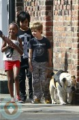 Shiloh, Zahara and Maddox walk the dog in New Orleans
