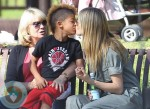 heidi Klum giving son Johan a kidd at the park
