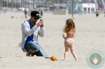 Joel Madden with daughter Harlow at the beach