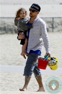 Joel and Sparrow Madden at the beach