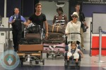 Kourtney Kardashian, Scott Disick and Mason Disick at LAX